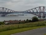 QE2 framed by the Forth Bridge
